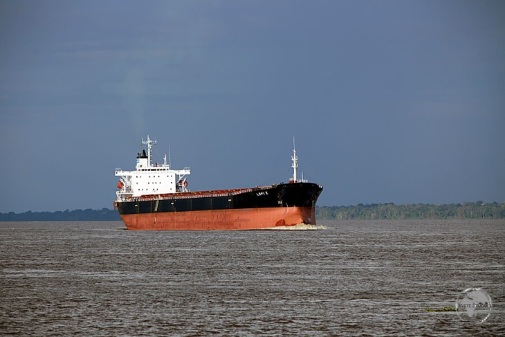 A long way from the Atlantic ocean - 1,400 km upriver on the Amazon river, an ocean-going freighter approaches Manaus port.