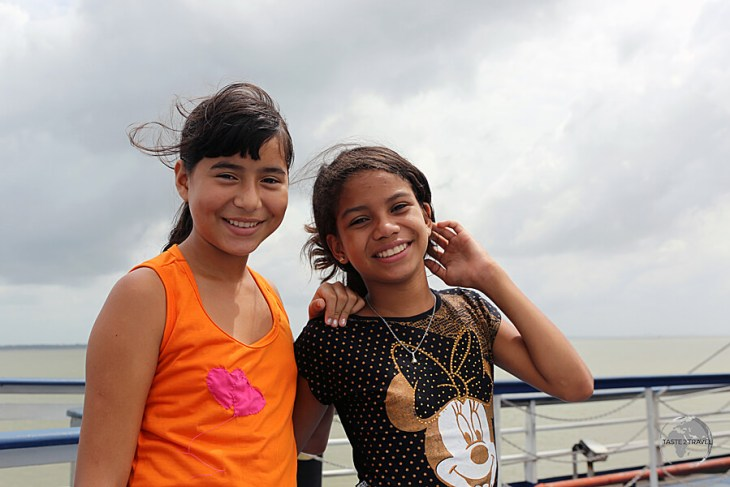 Two fellow passengers, who loved posing for my camera, on the boat from Belém to Macapá.