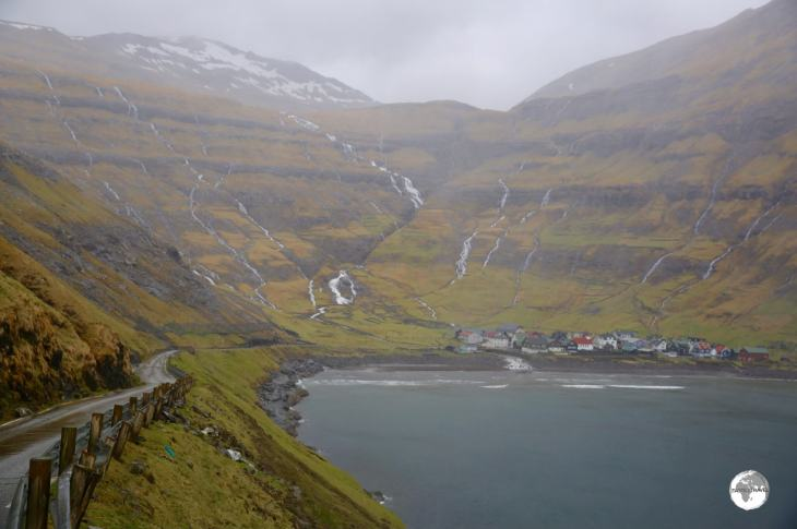 A view of the very narrow route 594 as it makes its final descent into the coastal village of Tjørnuvík.