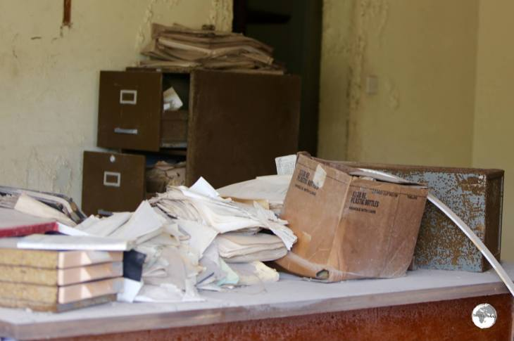Files and paperwork remain where they were left in an abandoned office in Plymouth.
