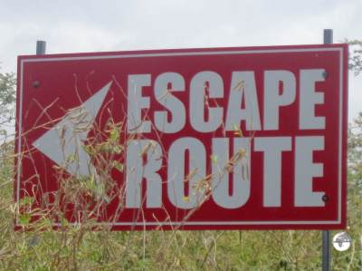 Signage inside the exclusion zone indicates the best escape route.