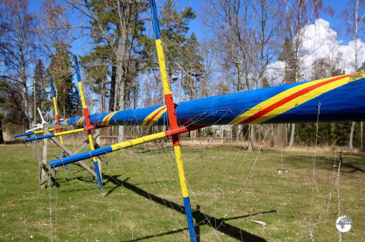A Maypole painted in the colours of the Åland flag being prepared for the upcoming mid-summer festivities.
