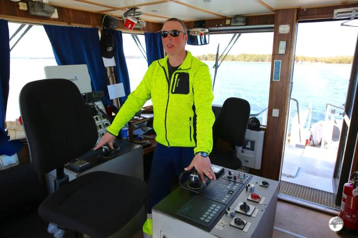 The Captain on the bridge of a Cable ferry on Vårdö Island.
