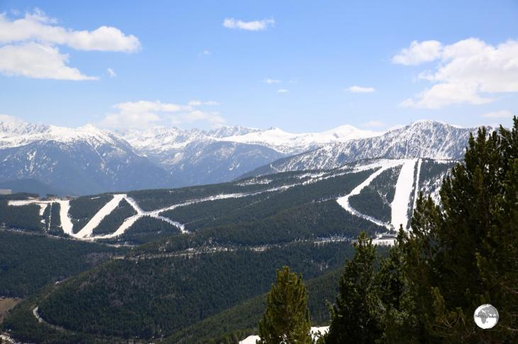 The white slopes of the Vallnord Pal Ski resort cut a clear path across the mountain.