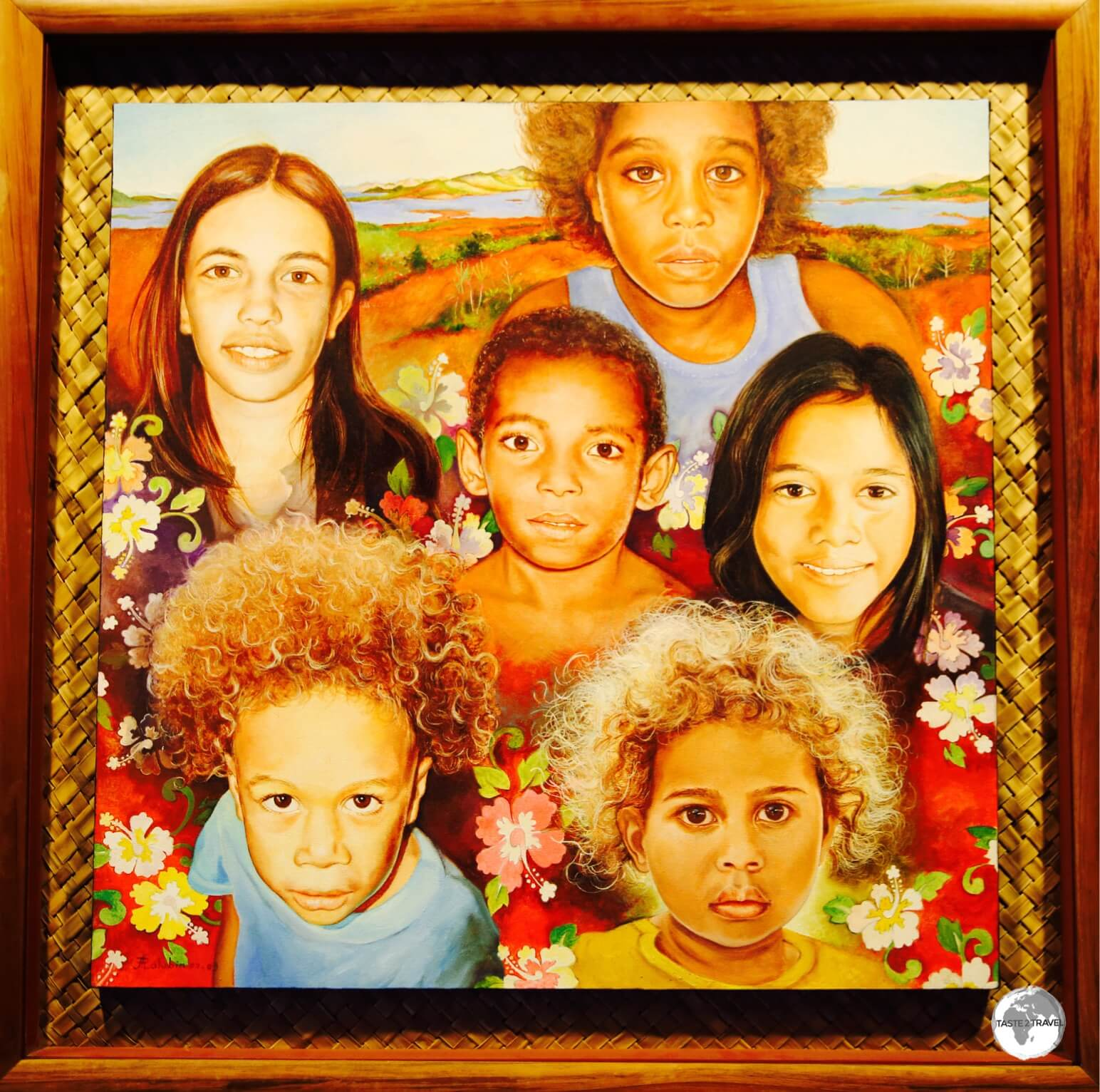 Artwork depicting the faces of New Caledonia at the Museum of New Caledonia.