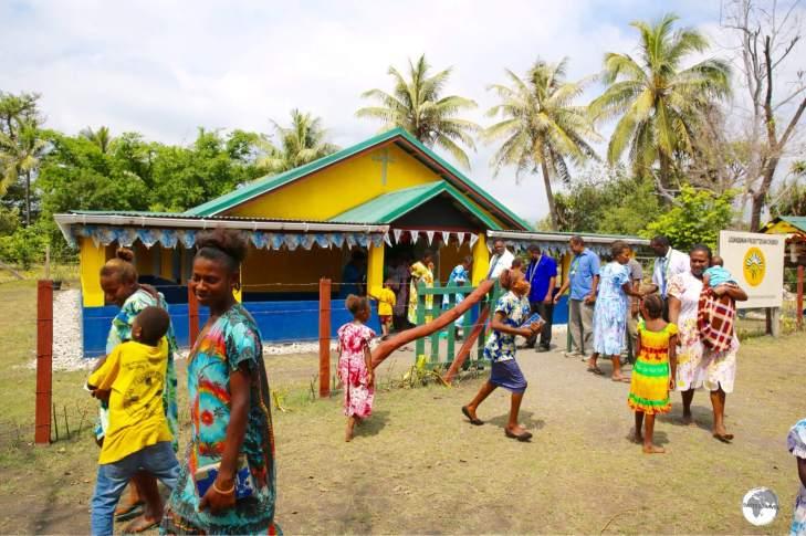 Attending church in the village of Louna Sunan.