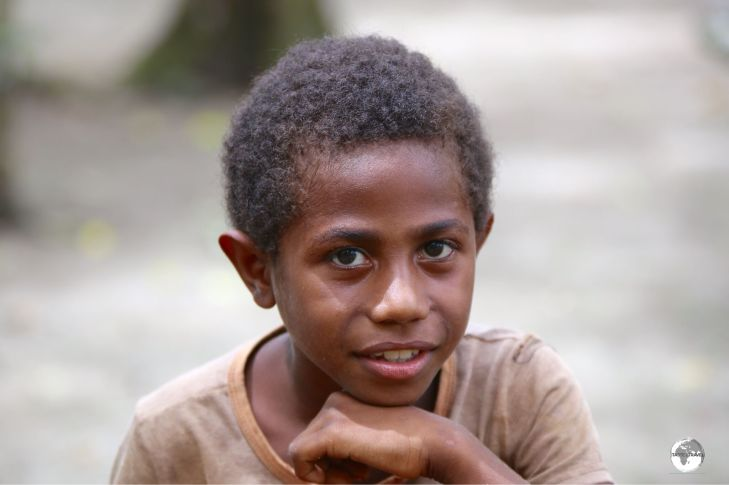 One of the many friendly village children on Malo Island.