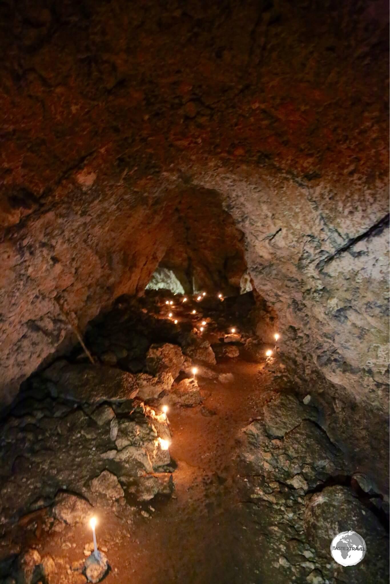 A large cavern on Lelepa island is illuminated by candlelight.
