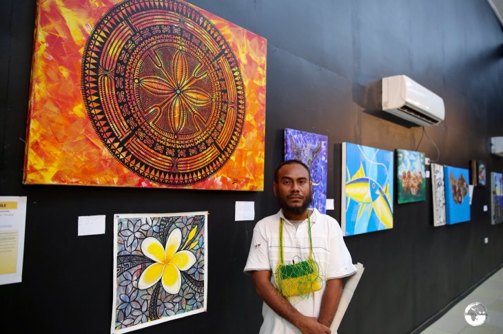 Local artist 'Pollo' explaining his works at the Art Gallery in Honiara.