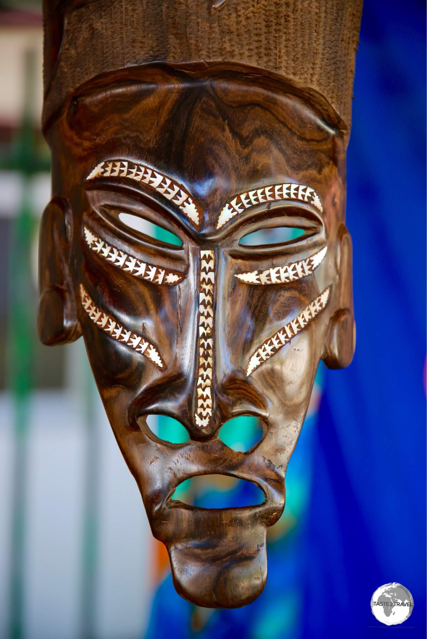 Carved masks are popular souvenirs.