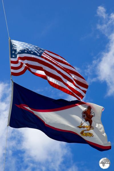 "The territorial flag of American Samoa flies underneath the US ""Stars and Stripes"" in Pago Pago."