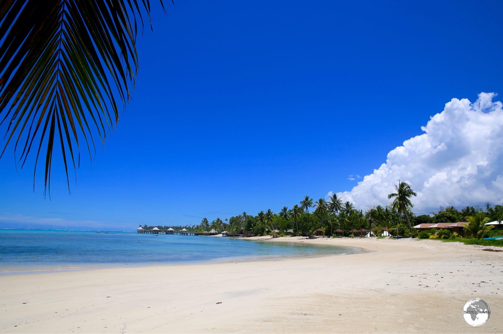 Beautiful Maninoa beach lies between Sinalei Reef Resort & Spa and Coconuts Beach Club Resort & Spa (background).