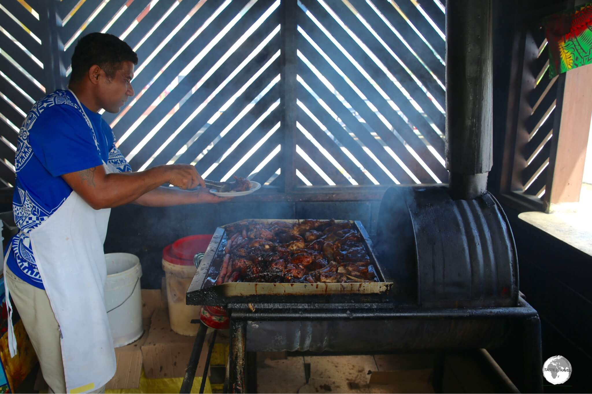 The grill master at Loui's BBQ restaurant.