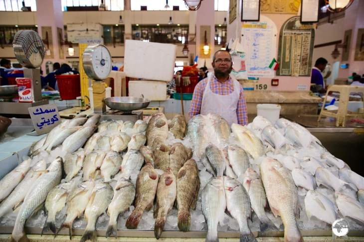A fish monger with his produce at the Kuwait Central Fish market.