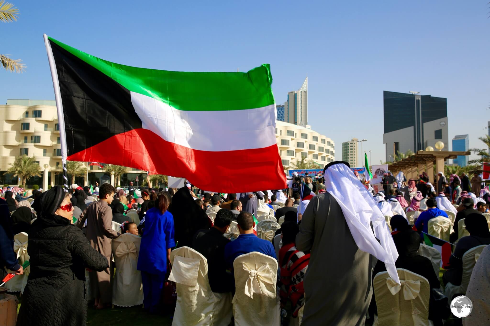 The Kuwaiti flag is flown everywhere throughout the country, including at this political rally in Kuwait city.