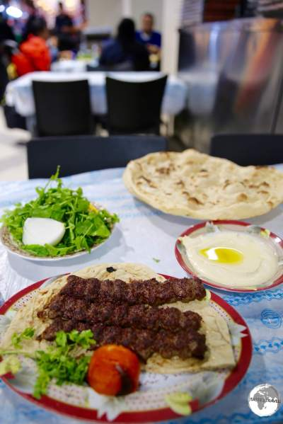 A perfect meal of spicy Kofte, creamy Humus and crispy flatbread, fresh from the Tandoor oven at Souk Al-Mubarakiya.