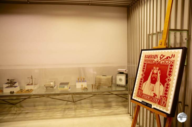 A display at the Postal Museum features the first stamp issued by Bahrain in 1953.