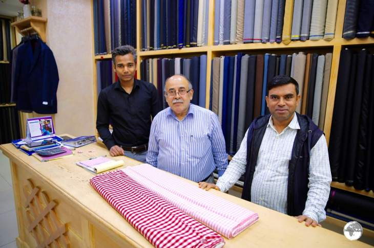 The friendly team of Indian tailors from 'Washington Tailors' in Manama Souk.