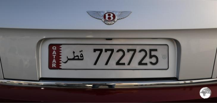 All Qatari license plates, including on this beautiful Bentley, feature the national flag. Note the Bentley logo is also in 'Qatar Maroon'.