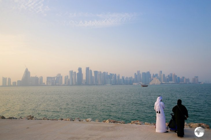 A Qatari couple admiring the Doha skyline from MIA park.