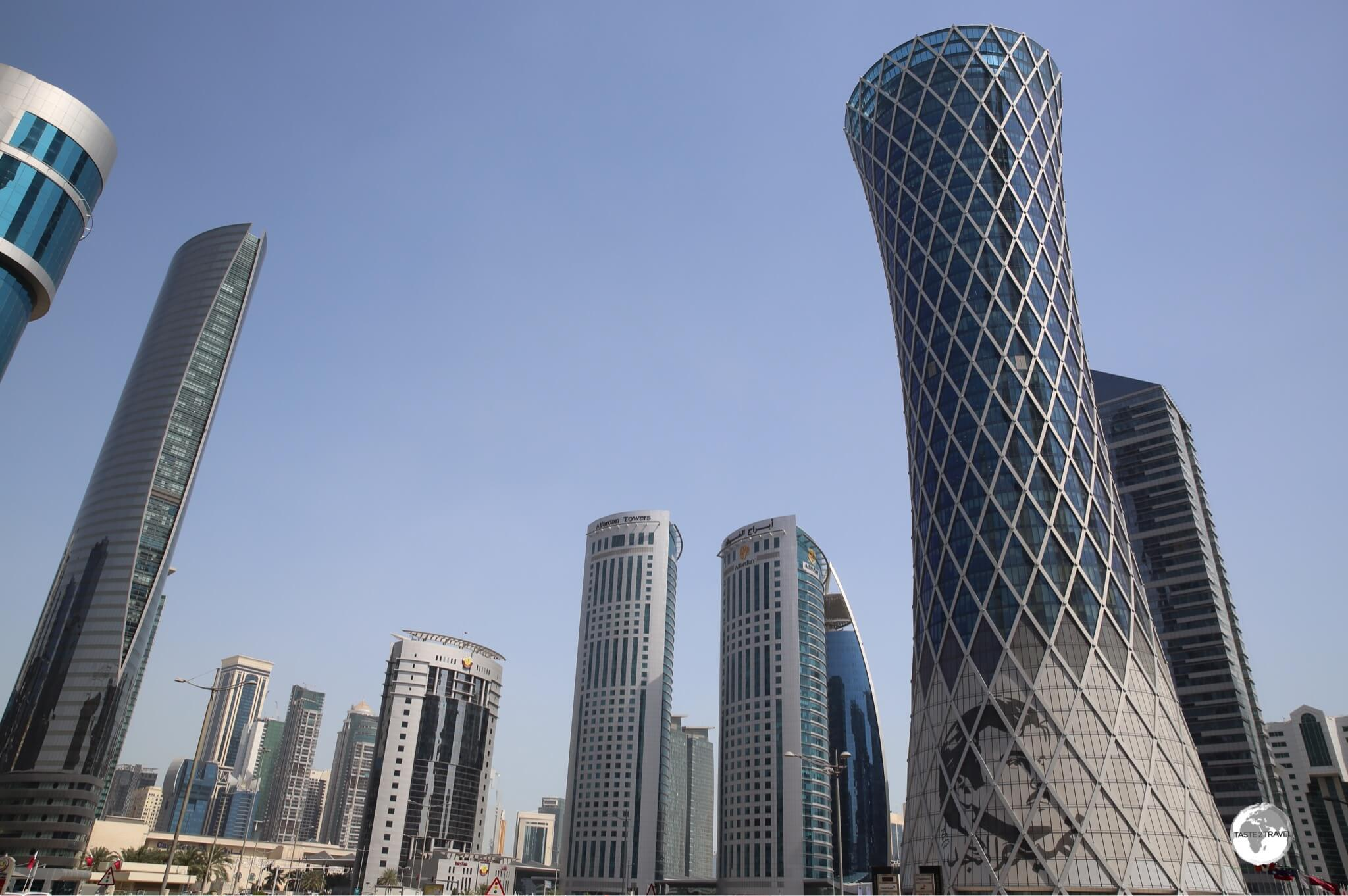 Buildings all over Doha, such as the Tomado Tower, feature the standard silhouetted image of the Emir of Qatar.