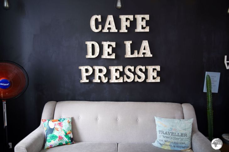 My favourite sofa (with the 'Traveller' cushion) at Cafe De La Presse.