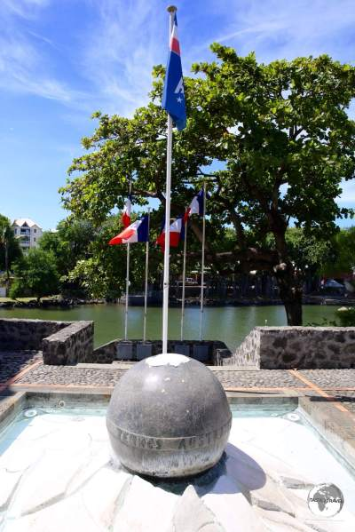 A monument at the TAAF information centre in St. Pierre shows the location of the territories on a globe.