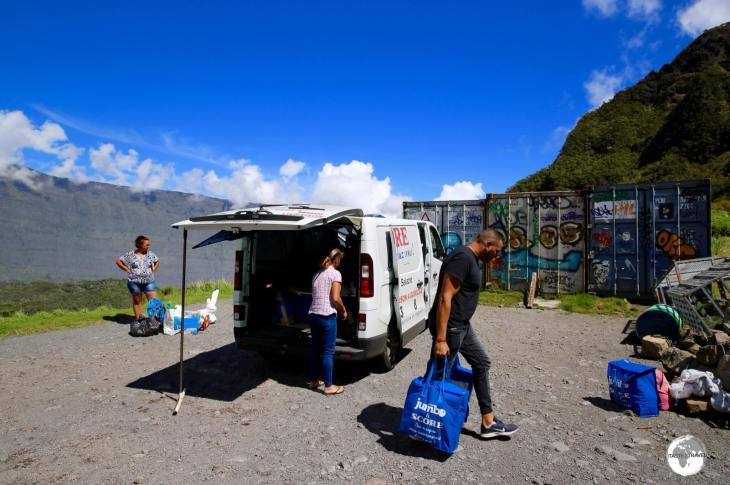 A local supermarket provides grocery delivery for the residents of La Nouvelle with perishable items being stored in refrigerated containers until they are collected.