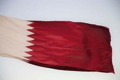 The flag of Qatar.