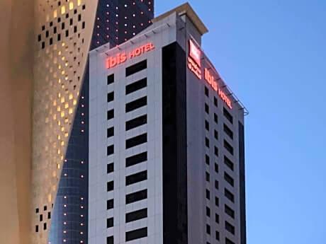 The Ibis Sharq Hotel is dwarfed by Al Hamra tower.