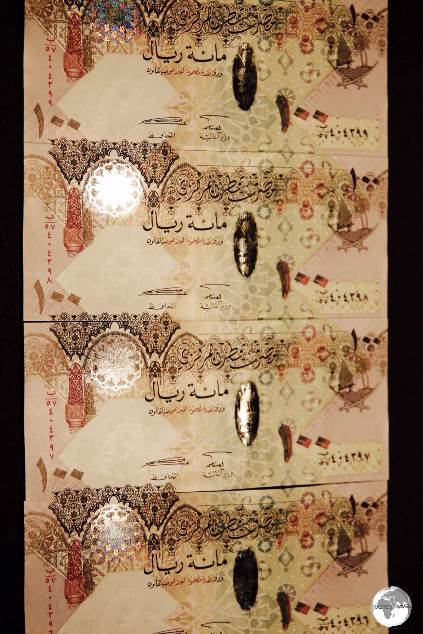Qatari 100 Riyal notes.