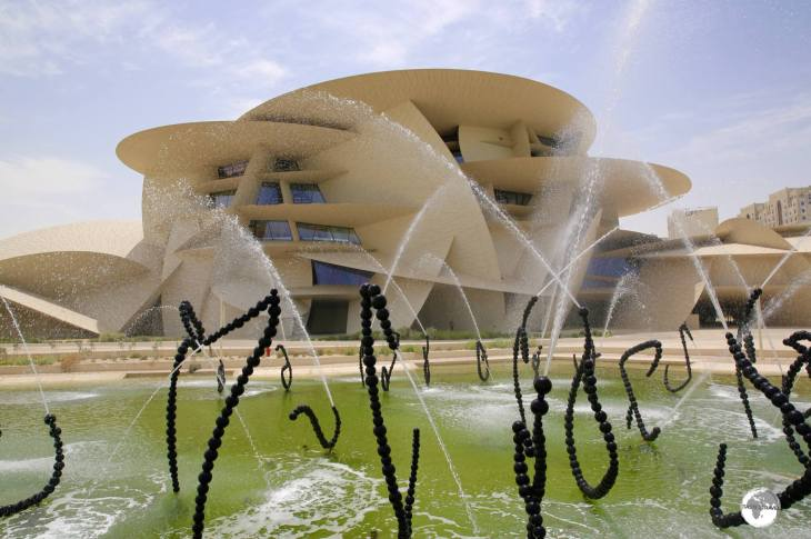 "A view of the National Museum of Qatar and Jean-Michel Othoniel's ""ALFA"", a water feature which consists of 114 fountain sculptures."