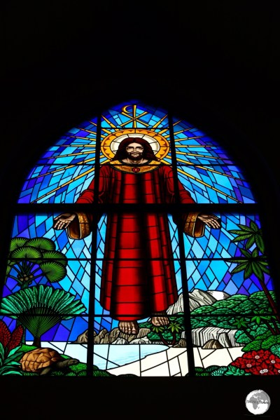 The window above the narthex of St. Paul's features Jesus floating above a typical Seychellois island with granite boulders, palm trees and an Aldabra giant tortoise.