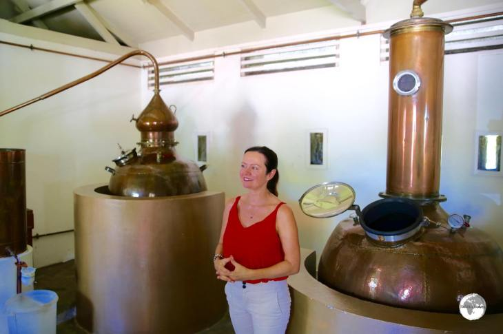 A friendly staff member at Takamaka rum conducting a tour.