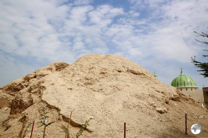 One of the 17 royal mounds that lie among the urban sprawl of A'Ali township