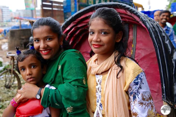 Girls squeezed onto a Bicycle Rickshaw in old Dhaka.