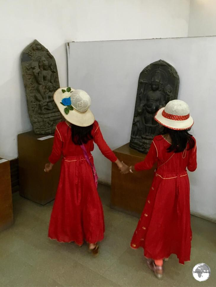 Twin sisters exploring a gallery at the Bangladesh National Museum.