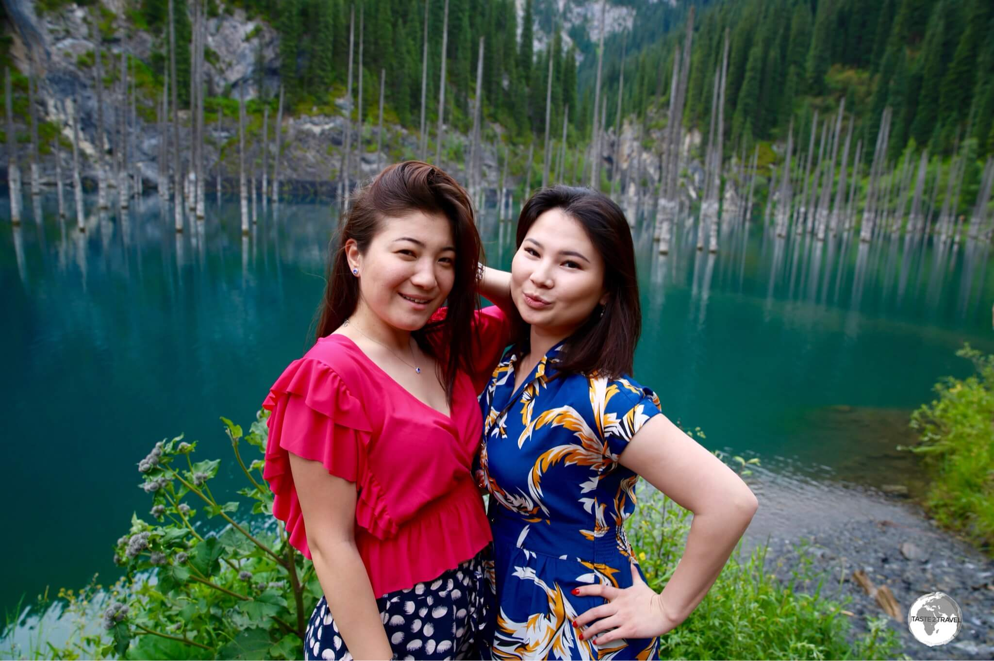 Two Kazakh girls striking a pose on the shores of Lake Kaindy.
