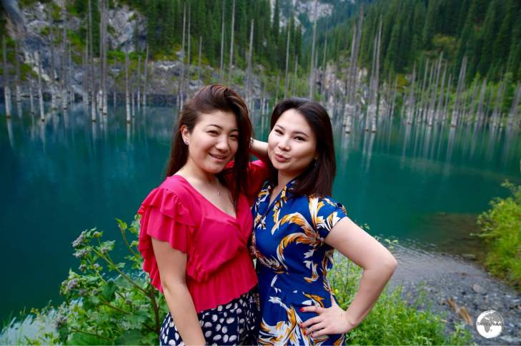 Two Kazakh girls striking a pose on the shores of Lake Kaindy.