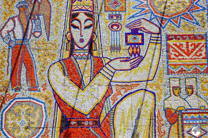 """""""The Girl with the Souvenir"""" is a tile mosaic which has been installed at Kok Tobe."""