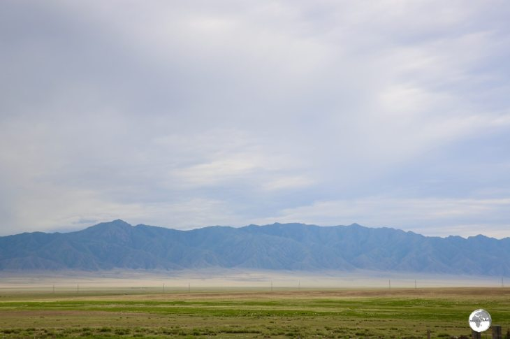 Wide open plains meet the towering Tien Shan mountains near Almaty.