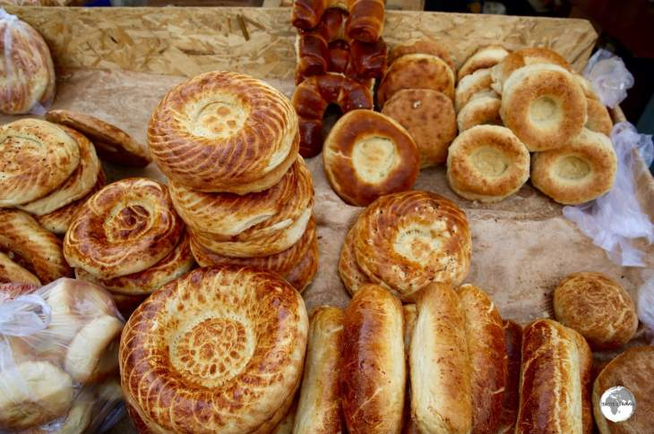 The bakeries of Karakol market are famous for their <i>Mai Tokoch</i>, a round Uighur-style bread which is baked in a clay tandoori oven.