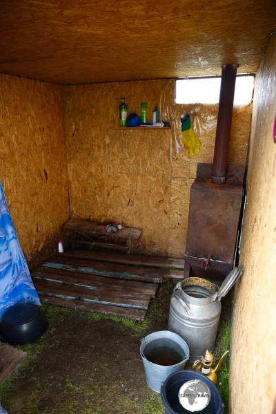 The shower at the yurt camp, where ice-cold mountain water is heated using a manure-fired stove.