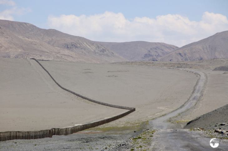 The Pamir highway travels alongside a continuous barbed-wire fence which was built by the Chinese as a border fortification.