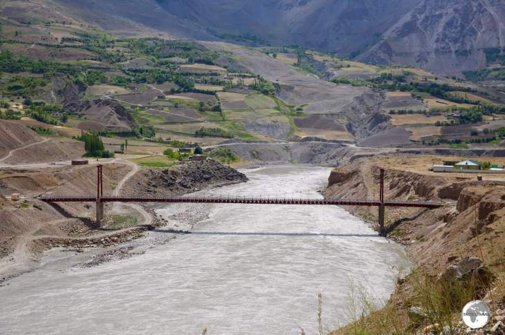 The Tajikistan-Afghanistan Friendship Bridge spans the Panj river at Darvaz.