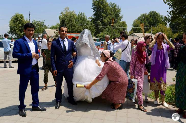 A Tajik wedding party visiting Hissar fort.