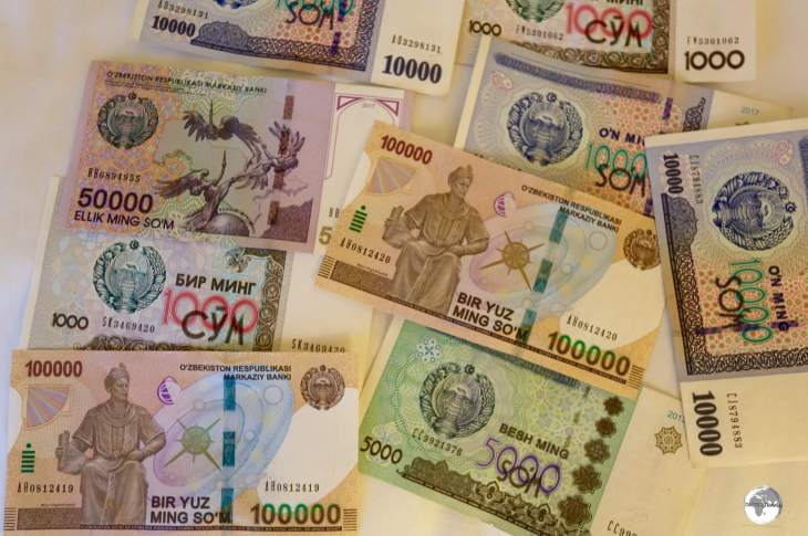 Uzbek som currency, showing the newly released 100,000 som note.