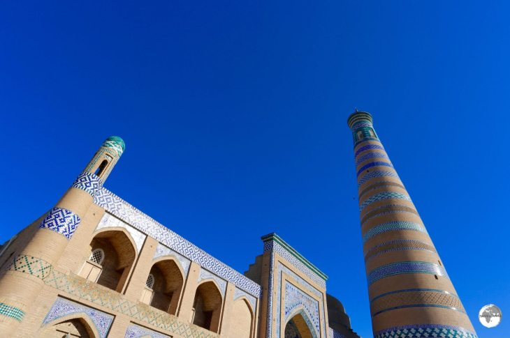 The Islam Khoja Minaret, the tallest in Uzbekistan, towers over the madrasah.