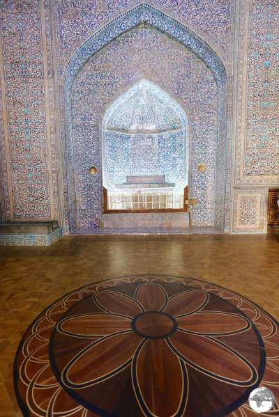 The tomb of Pahlavan Mahmud surrounded by the intricate wooden parquet floor of the mausoleum.