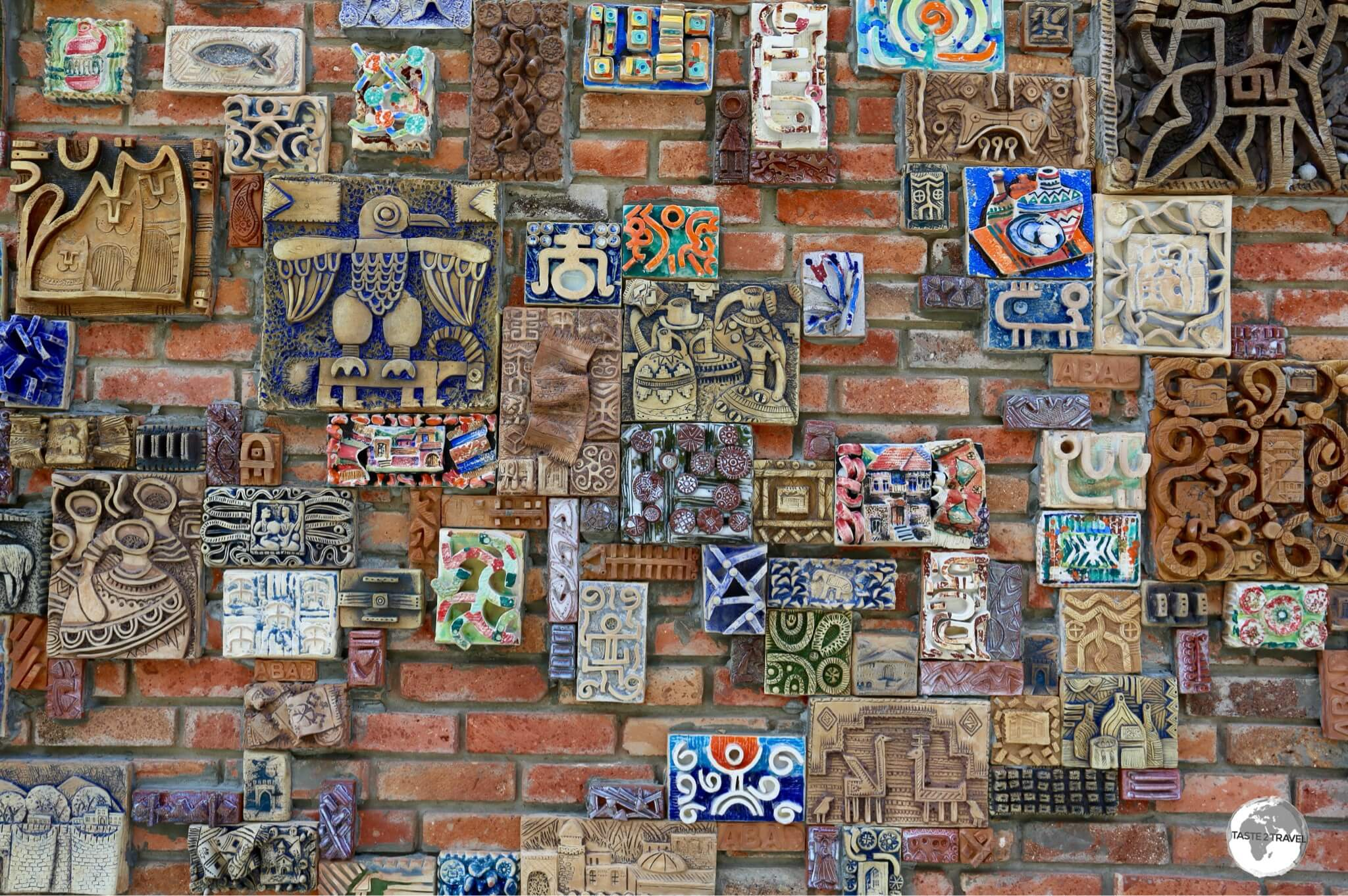 The wall of the arts and craft centre features locally made ceramic artwork.